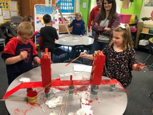First grade students building a bridge.