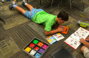 A student creating a video game using Bloxels and an iPad.