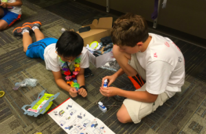 Two students exploring a Little Bits programming set.