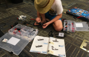 A student starting a Lego Mindstorms robot.