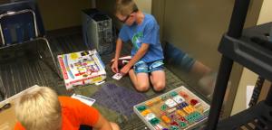 A student exploring the electronic circuit set.