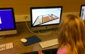 A future architect using FloorPlanner software on the computer.