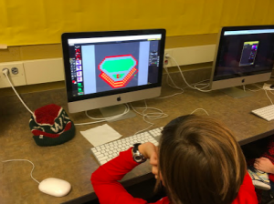 A student creating an animation on the computer with Piskels.