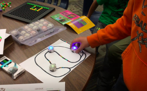 A student coding with Ozobots.